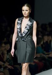 A model presents a creation by Kazakhstani designer Kamila Kurbani during Kazakhstan Fashion Week in Almaty