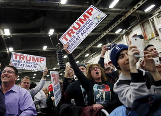 Supporters of U.S. Republican presidential candidate Donald Trump cheer during a campaign event at Grumman Studios in Bethpage, New York