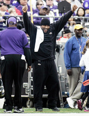 Ray Lewis of the Ravens cheers on the team from the sidelines in Baltimore