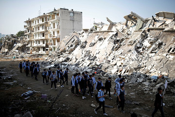 High school students take part in a large-scale earthquake simulation exercise in Seoul