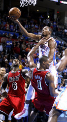 Thunder forward Durant shoots against Heat's James and Bosh in the second half of their NBA basketball game in Oklahoma City,
