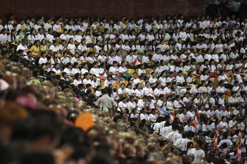 Hardline Buddhist monks and supporters celebrate the recent establishment of four controversial bills decried by rights groups as aimed at discriminating against the country's Muslim minority, with a rally in a stadium at Yangon