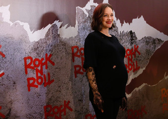"""Actress Marion Cotillard poses at a premiere of the film """"Rock'n Roll"""" in Paris"""