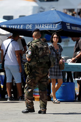 A French soldier patrols at the Old Harbour in Marseille to maintain security after French lawmakers approved a six-month extension of emergency rule within France