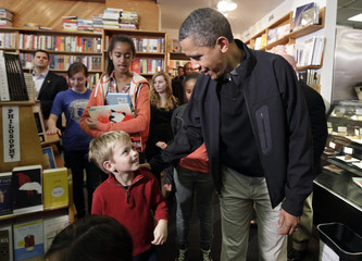 President Barack Obama with his daughters visits Kramerbooks