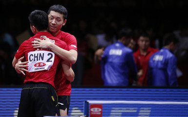 China's Ma celebrates with Xu after defeating Germany's Ovtcharov in men's final match at World Team Table Tennis Championships in Tokyo