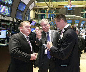 Prime Minister of Denmark Lars Rasmussen speaks with NYSE Euronext CEO, Duncan Niederauer and Neil Catania of MND Partners during a tour of the floor of the New York Stock Exchange