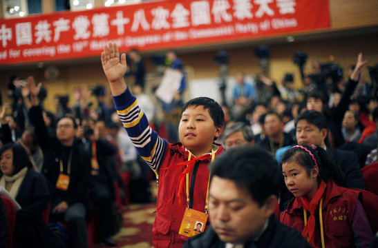 Zhang Jiahe raises his hand to ask a question during a news conference with Jiang Weixin, minister and secretary of the CPC Leadership Group of the Ministry of Housing And Urban-Rural Development, during NPC in Beijing