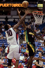 Panama's Ayarza has a shot blocked by Jamaica's Howell Ennis during their men's Centrobasket Championship bronze medal basketball game at the Jose Miguel Agrelot Coliseum in San Juan