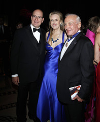 Prince Albert of Monaco poses for a photo with former astronaut Aldrin and Eaton following the Princess Grace Awards in New York