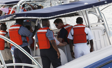 Britain's Prince Harry takes a boat to Harbour Island in Nassau
