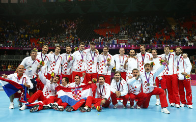 Croatia's players pose with their bronze medals at the men's handball victory ceremony during the London 2012 Olympic Games at the Basketball Arena
