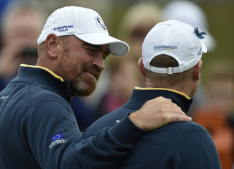 European Ryder Cup player Thomas Bjorn and Jamie Donaldson speak during practice ahead of the 2014 Ryder Cup at Gleneagles