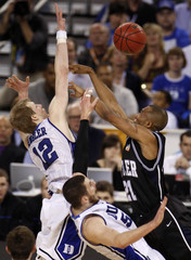 Butler's Veasley is defended against by Duke's Zoubek and Singler during their NCAA national championship college basketball game in Indianapolis