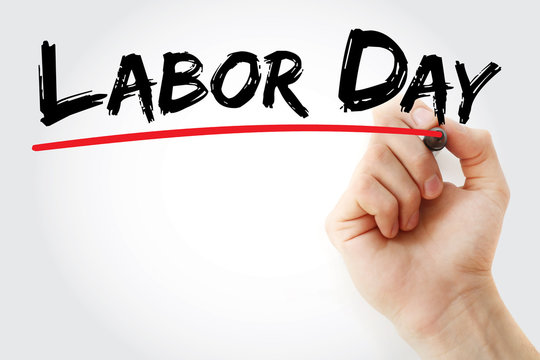 Hand writing Labor Day with marker, concept background
