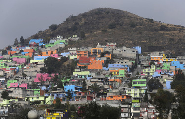 A general view shows houses on the side of a hill in Ecatepec