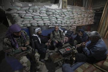 Free Syrian army fighters rest behind sandbags in Deir al-Zor, eastern Syria
