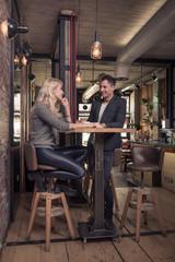 two people, woman man talking, coffee shop indoors