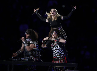 Madonna performs during the halftime show at the NFL Super Bowl XLVI football game in Indianapolis
