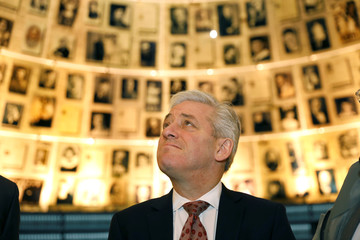 The Speaker of the House of Commons John Bercow looks at pictures of Jews killed in the Holocaust during a visit to the Hall of Names at Yad Vashem's Holocaust History Museum in Jerusalem
