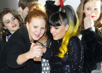Singer Lily Allen has her photograph taken with a fan as she arrives for the BRIT Awards, celebrating British pop music, in London