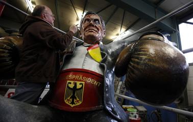 Artist works papier mache figure for a carnival float depicting German President Wulff  in Mainz