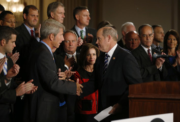 Schrader and Ribble shake hands as they gather to call for a solution to end the U.S. Government shut down on Capitol Hill in Washington