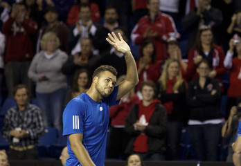 Jo-Wilfried Tsonga of France waves after defeating Frank Dancevic of Canada during their Davis Cup tennis match in Vancouver