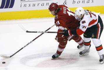 Ottawa Senators' Nick Foligno battles for the puck with Phoenix Coyotes' Martin Hanzal in their NHL game in Glendale