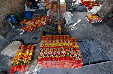 A man packs sparklers for sale at a factory ahead of Diwali, the Hindu festival of lights, on the outskirts of Kolkata