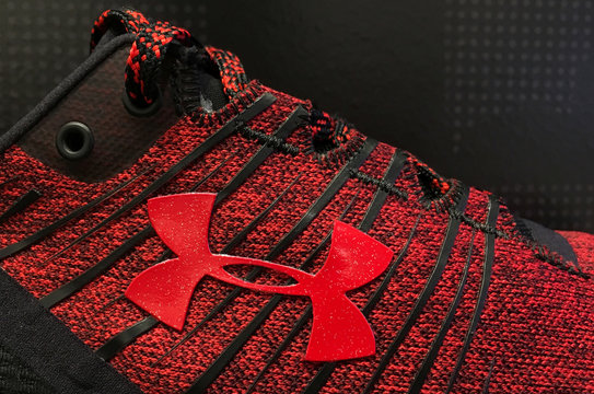 An Under Armour logo is seen on a running shoe on display at an store in Chicago
