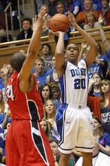 Duke University's Dawkins shoots over the defense of Bradley University's Warren during the first half of their NCAA basketball game in Durham