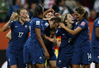 Players of France celebrate a goal against Canada during their Women's World Cup Group A soccer match in Bochum