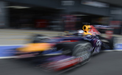 Red Bull Formula One driver Vettel drives out of pit lane during qualifying for British Grand Prix at the Silverstone Race circuit
