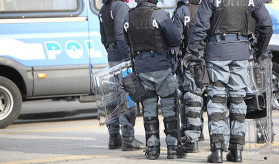 Italian anti-riot policemen with protective helmet control the city