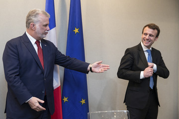 Quebec Premier Philippe Couillard and French Economy minister Emmanuel Macron attend a signing ceremony of economic partnerships between Quebec and France in Paris