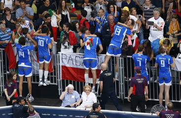 Italy's players celebrate with family members and fans after winning their men's bronze medal volleyball match against Bulgaria at Earls Court during the London 2012 Olympic Games