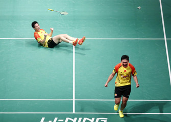 China's Liu with partner Qiu celebrate after winning against South Korea's Ko and Lee during their men's doubles match at the finals in Kuala Lumpur