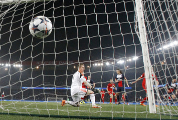 Paris St Germain's Ezequiel Lavezzi scores against Bayer Leverkusen during their Champions League round of 16 second leg soccer match at the Parc des Princes Stadium in Paris