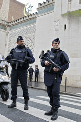 French police stand in front of the entrance of Paris Mosque as French Muslims gather for Friday prayers in Paris