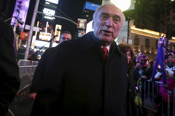 New York Police Commissioner Bill Bratton walks though Times Square during New Year celebrations in the Manhattan borough of New York