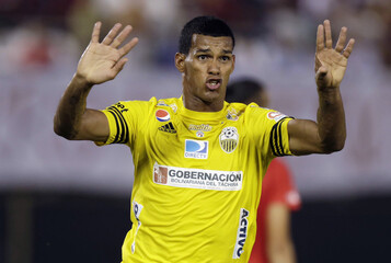 Rivas of Venezuela's Deportivo Tachira gestures as he celebrates after scoring a goal against Paraguay's Cerro Porteno during their Copa Libertadores soccer match in Asuncion