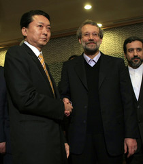 Iran's parliament speaker Ali Larijani poses with Japan's Prime Minister Yukio Hatoyama prior to a reception in Tokyo