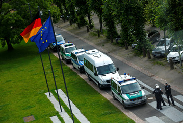 Police cars stand outside the Germany Constitutional Court headquarters during the ruling on the legality of a European Central Bank emergency bond-buying scheme in Karlsruhe
