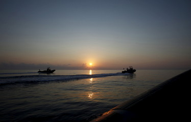Members of Libya's Navy are seen during a patrol off Tripoli