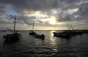 Fishing boats are anchored at the shores of the Indian Ocean in Shela Island of Lamu, near the beach home of a French woman held hostage
