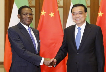 Equatorial Guinea's President Teodoro Obiang Nguema Mbasogo shakes hands with Chinese Premier Li Keqiang before a meeting at the Great Hall of the People in Beijing