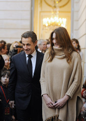France's President Sarkozy and his wife Carla attend the Christmas party at the Elysee Palace in Paris
