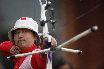 China's Fang Yuting fires an arrow in the women's archery team semifinals at the Lords Cricket Ground during the London 2012 Olympic Games