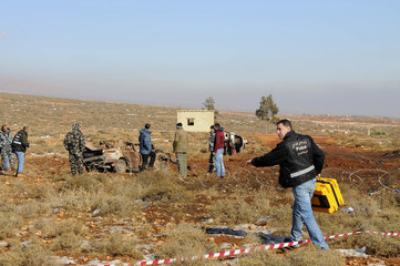 Lebanese army security inspect the explosion site, east of Baalbeck city in Lebanon's Bekaa valley